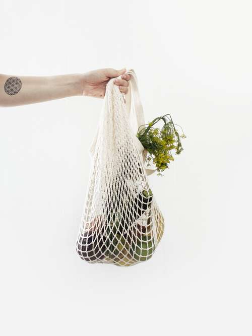 string bag of vegatables photo by sylvie tittel unsplash